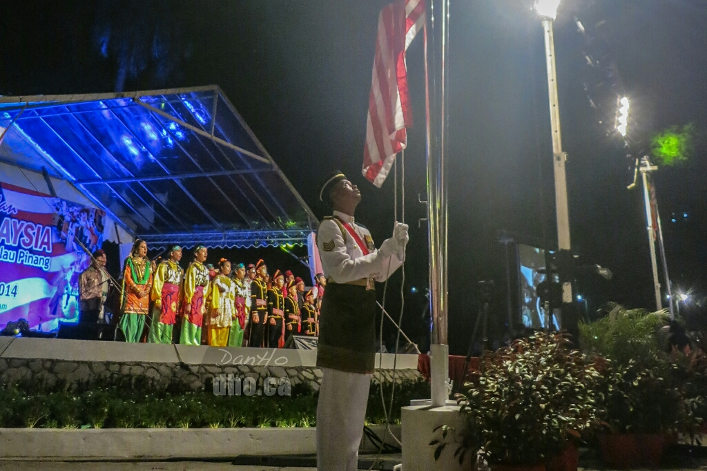 Flag raising ceremony at the Malaysia Day celebrations in Penang.